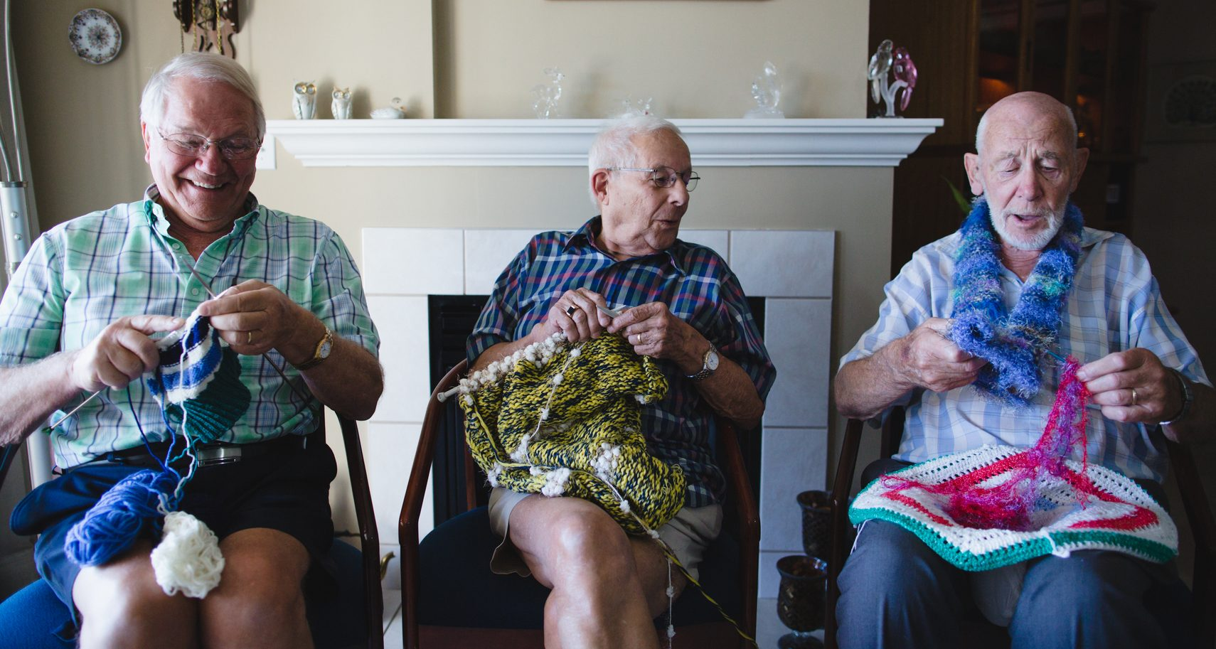 Group of senior men knitting together